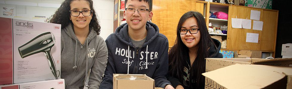 Sisler High grade 11 students (l-r) Ashley Amaral, Calvin Loi and Mae Anne Bathan display hygiene products that their group H.O.P.E. for the Homeless has collected in Winnipeg, Man. Wednesday December 17, 2014. The items will be donated to Siloam Mission.
