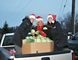 Brantford Power employees Alex Sweeney, Debbie Dean and Tina Peeler pick up a cabbage donation from Procyk Farms for competition to help the food bank. (Submitted Photo)
