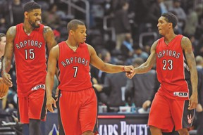 Raptors' (left to right) Amir Johnson, Kyle Lowry and Lou Williams celebrate after a win against the Hawks earlier this season. (USA TODAY SPORTS)