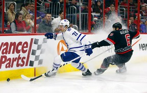Maple Leafs forward David Clarkson (left) gets to the puck ahead of Hurricanes defencemen Tim Gleason in Raleigh, N.C., last night. (USA TODAY)