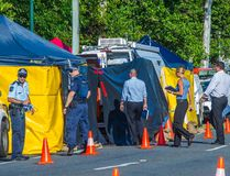 Detectives work at the scene of a stabbing attack at a home in Cairns, northern Queensland, December 19, 2014. (REUTERS/Stringer)