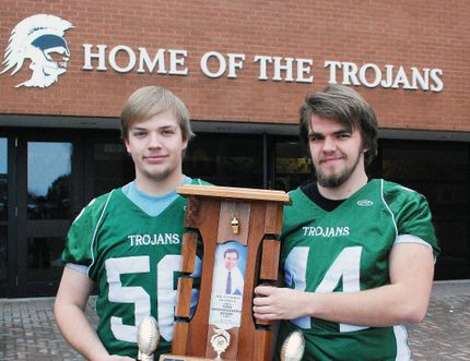 Dave Dale/The Nugget West Ferris Trojans senior football team offensive linemen Jacob Brown, left, and Connor Andrews, pose with the Rheal Perron Memorial Award for Team Sportsmanship. The NDA senior league champions for 2014 were given the h