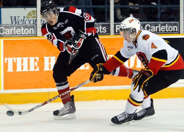 February 18, 2011  - Ottawa 67s' Cody Ceci (83) shoots past Belleville Bulls' Bjorn Krupp (4) during the first period of OHL action at Rona Centre in Ottawa Friday, February 18, 2011. (DARREN BROWN/OTTAWA SUN/QMI AGENCY)