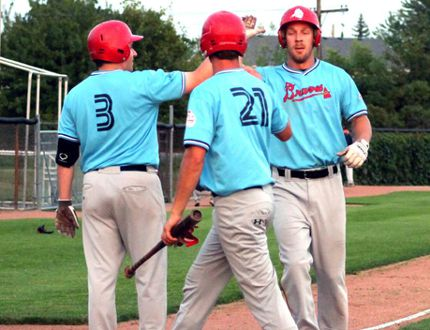 The Sarnia Braves decided recently to switch to the Southwestern Senior Baseball League for the 2015 season. Pictured celebrating a Mike Damchuk home run last season are, from left, centre fielder James Grant, left fielder Alex McLean and first baseman Damchuk. (Submitted photo)