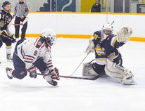 Port Dover Sailors forward Michael Almas backhands the puck past Dunnville Mudcats goaltender Josh Rosettani on Sunday for a shorthanded goal. The Sailors lost the match 6-2. (DANIEL R. PEARCE Simcoe Reformer)