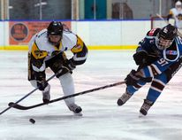 Dakota Culbert (left) of the Simcoe Storm moves the puck while being chased by a member of the Niagara Riverhawks during his team's 5-2 loss to the Niagara at Talbot Gardens on Sunday night. The Storm have lost 11 games in a row. (DANIEL R. PEARCE Simcoe Reformer)