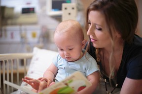 Submitted photo Desiree Lamoureux of Chelmsford reads to her son, Taylum, who is being treated at SickKids in Toronto for a rare kidney disease.