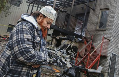 Shah Syed looks over the damage to his home on Cedarview Dr. in Scarborough after a suspicious fire broke out on his rear deck and spread into the house Wednesday December 24, 2014. (Dave Thomas/Toronto Sun)