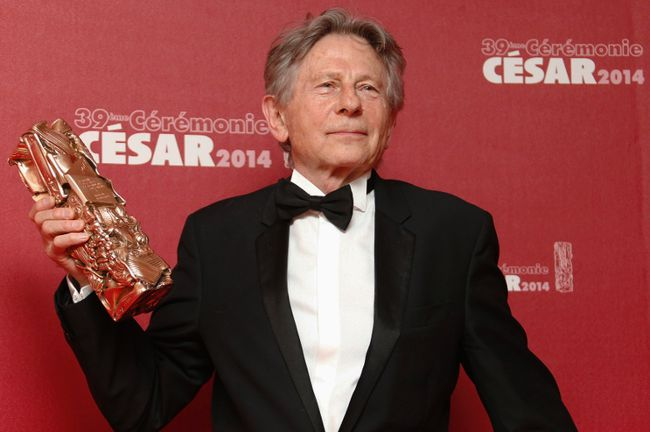 "Director Roman Polanski poses with his Best Director award for ""La Venus A La Fourrure"" (Venus in Fur) during a photocall at the 39th Cesar Awards ceremony in Paris in this file photo taken February 28, 2014. REUTERS/Regis Duvignau/Files"