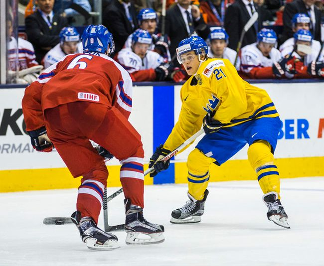 Sweden's William Nylander and Czech Republic's Lukas Klok during a IIHF World Junior Championship game at the Air Canada Centre in Toronto, Ont on December 26, 2014. (Ernest Doroszuk/Toronto Sun/QMI Agency)