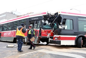 A TTC bus and streetcar collide at Main St. and Danforth Ave. on Dec. 27, 2014. (John Hanley/Special to the Toronto Sun)