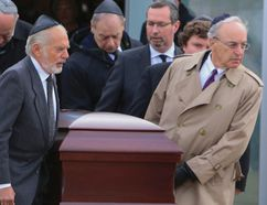 Pallbearers carry the casket of Edward Greenspan at Beth Torah Synagogue on Glenbrook Ave. in Toronto on Sunday December 28, 2014. (Dave Thomas/Toronto Sun)