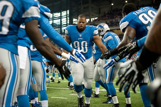 Detroit Lions defensive tackle Ndamukong Suh (90) is introduced prior to their game against the Jacksonville Jaguars at Ford Field. (Tim Fuller/USA TODAY Sports)