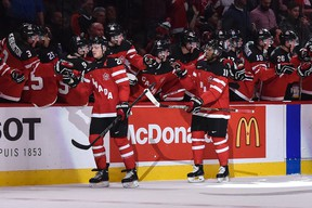 Canada's Sam Reinhart and Anthony Duclair are congratulated by their teammates after a goal during the 2015 IIHF World Junior Championship at the Bell Center on Dec. 29, 2014. (MICHEL DESBIENS/QMI AGENCY)