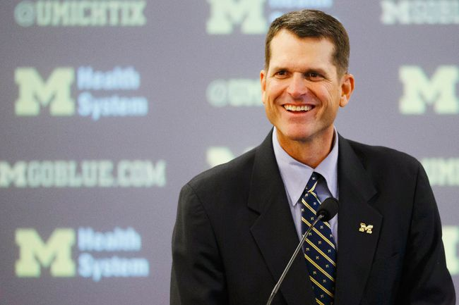 Jim Harbaugh speaks to the media as he is introduced as the new head coach of the Michigan Wolverines at Jonge Center. (Rick Osentoski/USA TODAY Sports)