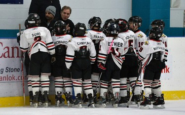 Ottawa Stings� coach Alexei Kovaleve talks to his team during their Major Atom AAA hockey game against the Westchester Express during the Bell Capital Cup at the Nepean Sportsplex in Ottawa on Tuesday, December 30, 2014. Matthew Usherwood/Ottawa Sun