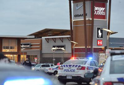 Police close the perimeter of Tangar Outlets Mall where a shooting occurred in Ottawa on Friday, Dec. 26, 2014. Matthew Usherwood/Ottawa Sun