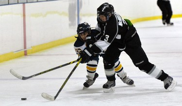 Ottawa Valley Silver Seven #3 Johnathan McMillian and North Jersey Avalanche�s #23 Anthony Maurice battle for the puck during Minor Peewee AAA hockey during the Bell Capital Cup at the Kanata Recreation Complex in Ottawa on Tuesday, December 30, 2014. Matthew Usherwood/Ottawa Sun