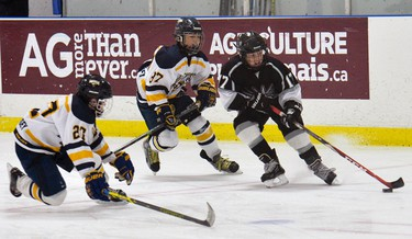 Ottawa Valley Silver Seven #17 Tyler Whyte makes his way past North Jersey Avalanche�s #27 Jake Howard and #87 Timmy Koltermann during Minor Peewee AAA hockey during the Bell Capital Cup at the Kanata Recreation Complex in Ottawa on Tuesday, December 30, 2014. Matthew Usherwood/Ottawa Sun