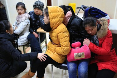 Relatives wait at a hospital where people injured in a stampede are being treated in Shanghai January 1, 2015. REUTERS/Aly Song