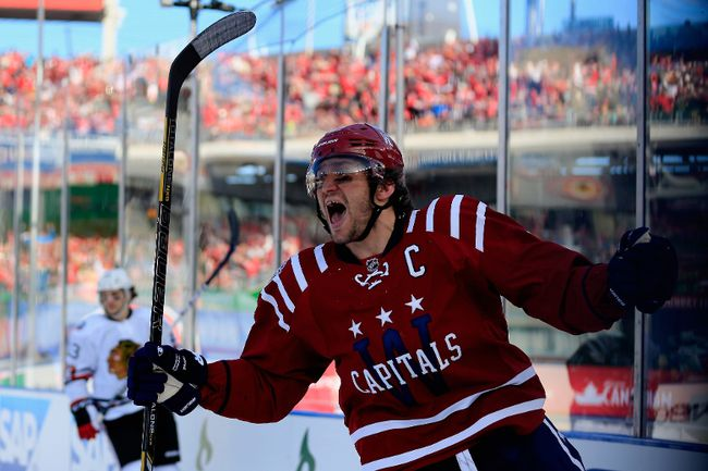 Alex Ovechkin #8 of the Washington Capitals celebrates after scoring in the first period of the 2015 NHL Winter Classic against the Chicago Blackhawks at Nationals Park on January 1, 2015 in Washington, DC. (Rob Carr/Getty Images/AFP)