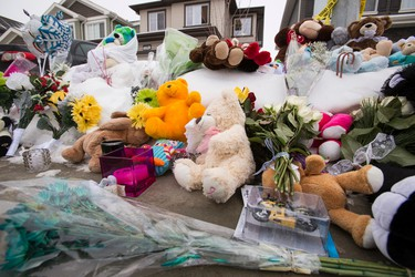 A memorial is seen for seven members of a family slain outside of their former home at 180A Avenue and 83 Street in Edmonton, Alta., on Thursday, Jan. 1, 2015. The slayings occurred on Dec. 29, 2014.  Sources say that 53-year-old Phu Lam is the killer; he later committed suicide inside a Fort Saskatchewan restaurant. Ian Kucerak/Edmonton Sun/ QMI Agency
