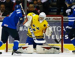 Finland's Aleski Mustonen (left) is stopped by Sweden goalie Linus Soderstrom during their World Junior Hockey Championship quarterfinal match at the Air Canada Centre in Toronto, Jan. 2, 2015. (JACK BOLAND/QMI Agency)