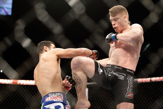Paul Felder kicks at Danny Castillo in a lightweight bout during UFC 182 in the MGM Grand Garden Arena on January 3, 2015 in Las Vegas. (Steve Marcus/Getty Images/AFP)