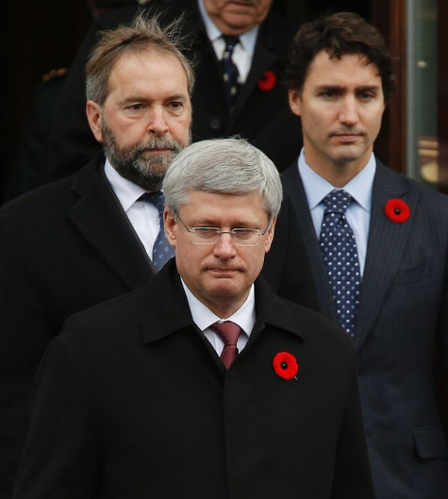 Prime Minister Stephen Harper (front), Leader of the Opposition Thomas Mulcair (top L) and Liberal leader Justin Trudeau leave the church following the funeral of Warrant Officer Patrice Vincent, in Longueuil, Quebec November 1, 2014.  REUTERS/Chris Wattie