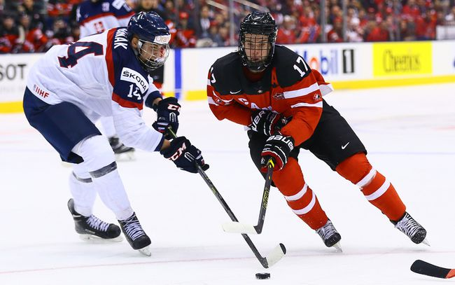 Connor McDavid of Canada skates around Erik Cernak of Slovakia during the semifinals of 2015 World Junior Championship at the Air Canada Centre in Toronto Sunday January 4, 2015. (Dave Abel/Toronto Sun/QMI Agency)