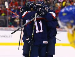 Slovakia celebrates winning the bronze medal over Sweden at 2015 World Junior Hockey Championships at the Air Canada Centre on January 5, 2015. (Dave Abel/Toronto Sun/QMI Agency)
