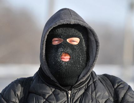 Mike Kennedy of Barrie had to slip on a balaclava during his walk to work Wednesday to fight off the biting cold. Mark Wanzel/Photo
