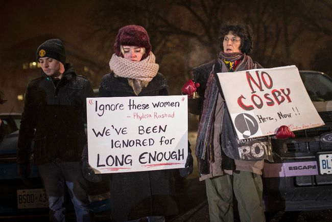 People protest at the Centre In The Square venue where Bill Cosby is performing in Kitchener, Ontario, January 7, 2015. Bill Cosby, the subject of more than a dozen sex abuse allegations over the past three months, will go ahead with three Canadian shows this week, coming as more women levelled accusations against the comedian.   REUTERS/Mark Blinch