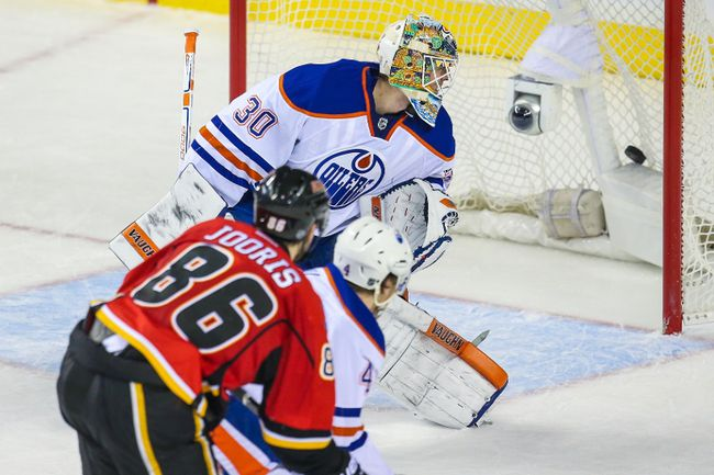 Edmonton Oilers goalie Ben Scrivens (30) reacts as Calgary Flames center Josh Jooris (86) scores the winning-goal during the overtime period at Scotiabank Saddledome, Dec. 31, 2014. Calgary Flames won in overtime 4-3. (Sergei Belski/USA TODAY Sports)
