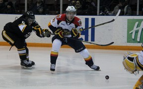 Connor McDavid of the Erie Otters eyes where to shoot on Sarnia Sting goalie Taylor Dupuis after gaining position on defenceman Jakob Chychrun in a game played Thursday, January 8, 2015. The Otters surrendered a three-goal lead and lost 4-3 to the Sting. (TERRY BRIDGE, The Observer)