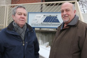 Michael Bosher, president of BKL Engineering, and Marty Raaymakers, president of MIG Engineering, pose for a photo outside the current MIG office in Sarnia where the two companies will join together when they merge in March. Between them, the two firms claim a stake in helping build more than 80% of Sarnia-Lambton's public infrastructure. TYLER KULA/ THE OBSERVER/ QMI AGENCY