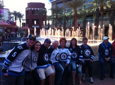 A large group of Jets fans pose outside the Gila River Arena in Glendale, Arizona, prior to the start of the Jan. 8, 2015 game between the Winnipeg Jets and the Arizona Coyotes. TED WYMAN/Winnipeg Sun/QMI Agency