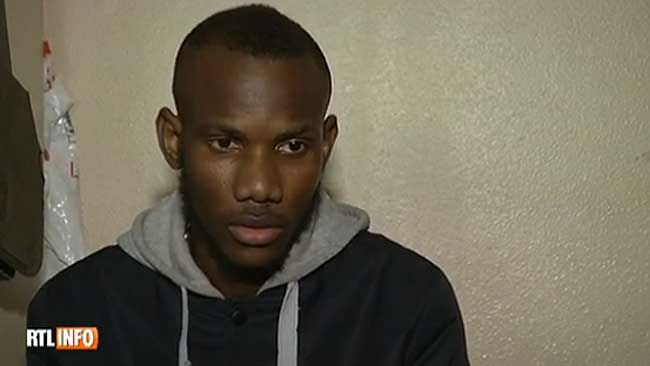 """A screengrab of Lassana Bathily,24, a young Muslim deli clerk who was working at Hyper Cacher store in Paris during Friday's deadly hostage-taking, is being hailed as a hero. (<A HREF=""""http://www.rtl.be/info/monde/france/lassana-heros-lors-de-la-prise-d-otage-a-paris-je-leur-ai-ouvert-la-porte-du-congelateur--690614.aspx"""" TARGET=""""newwindow"""">http://www.rtl.be</a>)"""