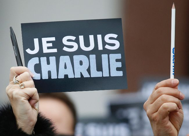 "An employee of the Council of Europe holds a placard which read ""I am Charlie"" and a pen, during a minute of silence in front of the Council of Europe in Strasbourg January 9, 2015, two days after gunmen stormed weekly satirical newspaper Charlie Hebdo in Paris. The two main suspects in the weekly satirical newspaper Charlie Hebdo killings were sighted on Friday in the northern French town of Dammartin-en-Goele where at least one person had been taken hostage, a police source said.    REUTERS/Vincent Kessler"