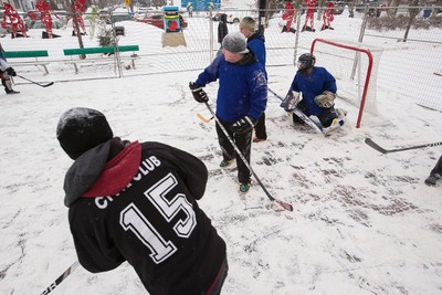 Street hockey players play a pickup game during Deep Freeze A Byzantine Festival along 118 Avenue near 92 Street in Edmonton, Alta., on Saturday, Jan. 10, 2015. The theme for 2015 is Return of the Vikings. Ian Kucerak/Edmonton Sun/ QMI Agency
