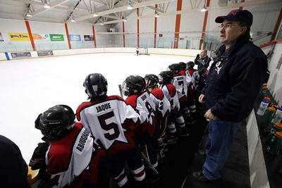 Coach John Findlay yells out instructions during the game. The North East Zone Eagles play their Minor Hockey Week game at South Side Arena against a Millwoods team in Edmonton, Alta., on Saturday Jan.10, 2015. Perry Mah/Edmonton Sun/QMI Agency