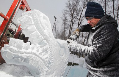 Barry Collier works on a dragon head ice sculpture in preparation for the Deep Freeze: Byzantine Winter Festival, at the Alberta Avenue Community League, 9210 118 Ave., in Edmonton Alta., on Wednesday Jan. 7, 2015. The Deep Freeze Festival runs January 10 and 11 along 118 Avenue near 92 Street. David Bloom/Edmonton Sun/QMI Agency