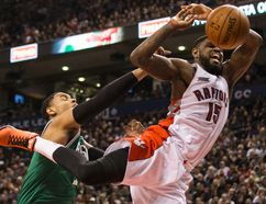 Celtics' Jared Sullinger brings down the hammer on the Raptors' Amir Johnson during the first half at the ACC last night. (Craig Robertson/Toronto Sun)