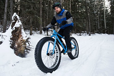 Chris Peel with Freewheel Cycle Jasper demonstrates a fatbike at Pyramid Lake Resort during the Jasper in January media weekend in Jasper, Alta., on Sunday, Jan. 11, 2015. Jasper in January runs from Jan. 16 to Feb. 1. Codie McLachlan/Edmonton Sun/QMI Agency