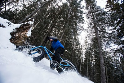 Chris Peel with Freewheel Cycle Jasper crashes while demonstrating a fatbike at Pyramid Lake Resort during the Jasper in January media weekend in Jasper, Alta., on Sunday, Jan. 11, 2015. Jasper in January runs from Jan. 16 to Feb. 1. Codie McLachlan/Edmonton Sun/QMI Agency