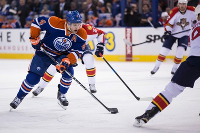 Edmonton forward Taylor Hall (4) carries the puck against Florida during the first period of a NHL hockey game between the Edmonton Oilers and the Florida Panthers at Rexall Place in Edmonton, Alta., on Sunday, Jan. 11, 2015. Ian Kucerak/Edmonton Sun/ QMI Agency