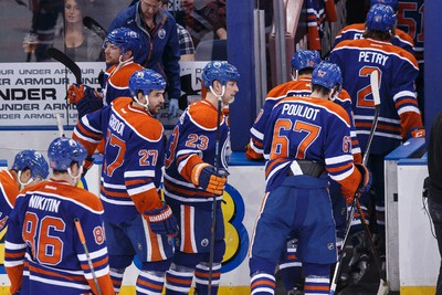 Edmonton players walk off the ice after losing a NHL hockey game between the Edmonton Oilers and the Florida Panthers at Rexall Place in Edmonton, Alta., on Sunday, Jan. 11, 2015. Ian Kucerak/Edmonton Sun/ QMI Agency