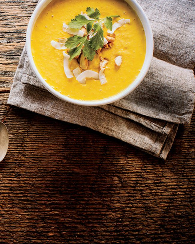 """<b>Carrot, Avocado & Coconut Soup</b> (Courtesy of Thrive Energy Cookbook by Brendan Brazier; DaCapo Press)<br><br> <b>Ingredients:</b><br><br> 1 ripe avocado, peeled<br> 1 small clove garlic, chopped 4 medium carrots, peeled and juiced<br> 4 cups (946 ml) coconut milk<br> 2 tsp. (10 ml) freshly squeezed lime juice<br> 1 tsp. (5 ml) yellow curry paste<br> Small handful of fresh cilantro leaves, torn<br> Sea salt and freshly ground black pepper<br> 1/2 cup (125 ml) roasted cashews, coarsely chopped<br><br>  <b>Special Equipment:</b><br>juice extractor and a blender.<br><br> <b>Directions:</b><br><br> In a blender, combine the avocado, garlic, carrot juice, coconut milk, lime juice, curry paste, half of the cilantro leaves, and salt and pepper to taste. Blend until smooth. Serve garnished with cashews and the remaining cilantro leaves. Serves 6.<br> <div id=""""pd_rating_holder_8017827""""></div> <script type=""""text/javascript""""> PDRTJS_settings_8017827 = { """"id"""" : """"8017827"""", """"unique_id"""" : """"default"""", """"title"""" : """""""", """"permalink"""" : """""""" }; (function(d,c,j){if(!document.getElementById(j)){var pd=d.createElement(c),s;pd.id=j;pd.src=('https:'==document.location.protocol)?'https://polldaddy.com/js/rating/rating.js':'http://i0.poll.fm/js/rating/rating.js';s=document.getElementsByTagName(c)[0];s.parentNode.insertBefore(pd,s);}}(document,'script','pd-rating-js')); </script>"""