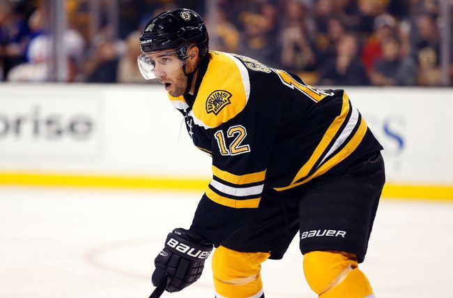 Simon Gagne (12) of the Boston Bruins during a game against the New York Islanders on September 30, 2014 at TD Garden in Boston.