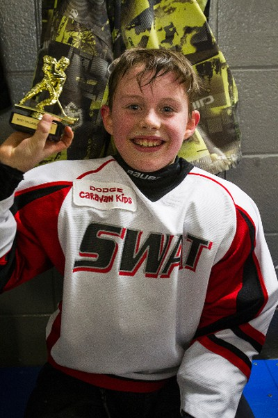 Harrison Boldt with the Swat Crushers gets the MVP trophy from head coach Steve Connors after the team's game with the North Seera Thunder during 2015 Quikcard Edmonton Minor Hockey Week play at Mill Woods Recreation Centre twin arenas in Edmonton, Alta., on Monday, Jan. 12, 2015. Minor hockey week runs from Jan. 9 - 18, 2015. Ian Kucerak/Edmonton Sun/ QMI Agency